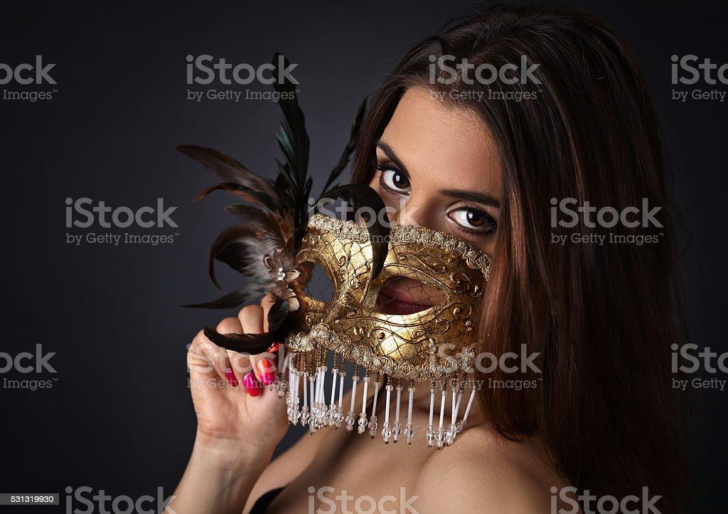 Beautiful woman with gold carnival mask stock photo