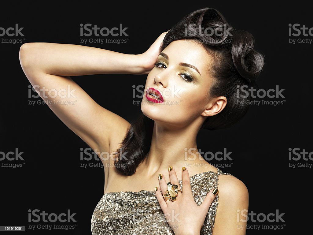 Beautiful woman with golden nails and fashion makeup royalty-free stock photo