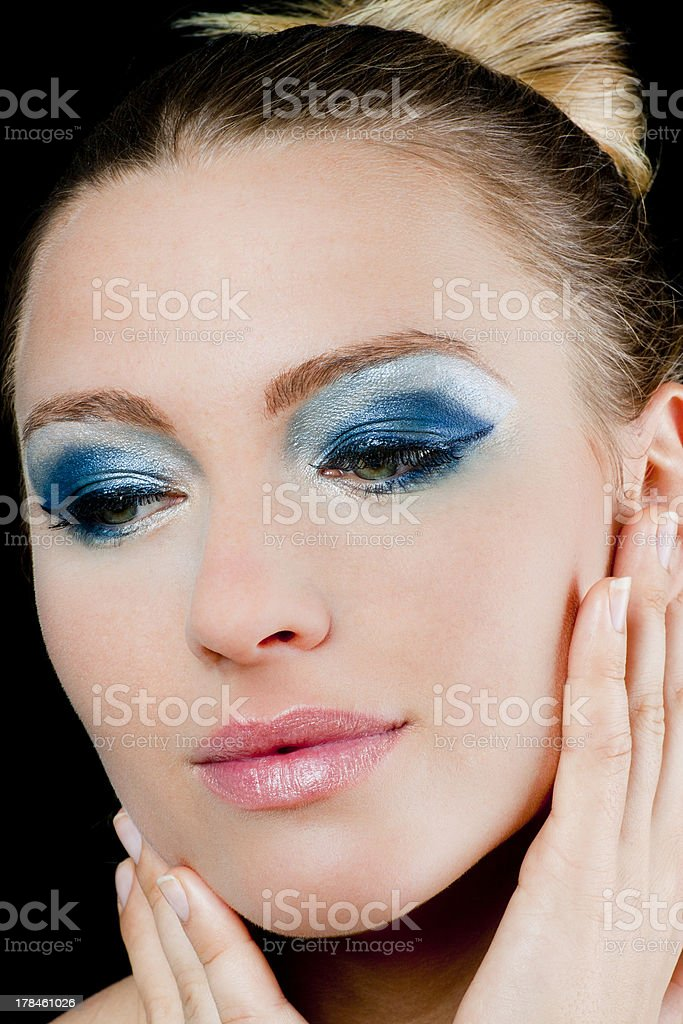 Beautiful woman with green eyes and blue makeup royalty-free stock photo