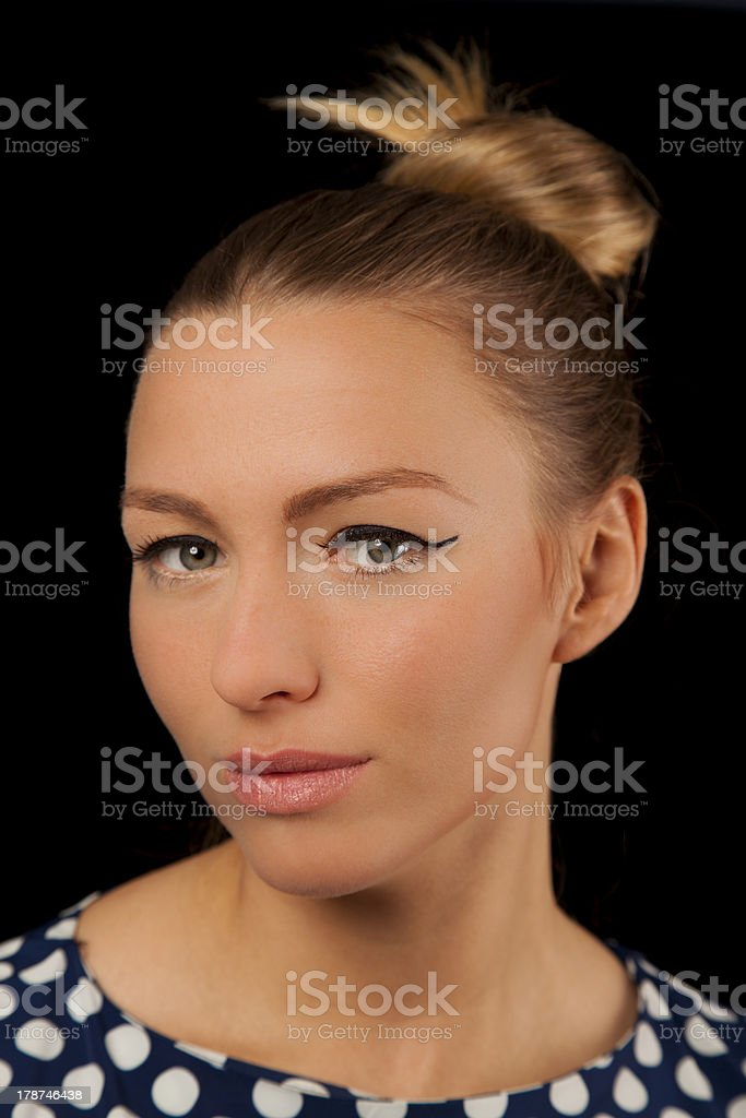Beautiful woman with green eyes and polka dot dress royalty-free stock photo