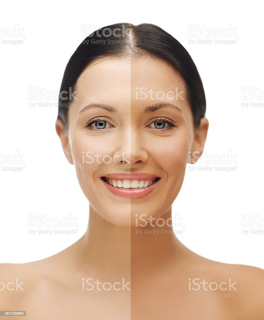 beautiful woman with half face tanned stock photo