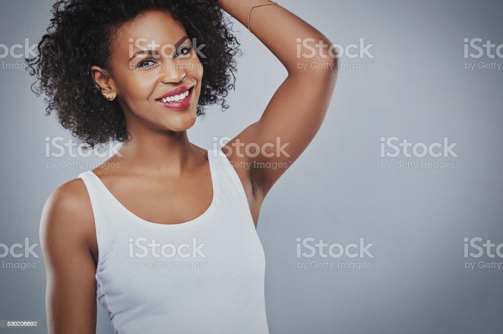 Beautiful woman with hand up toward head stock photo