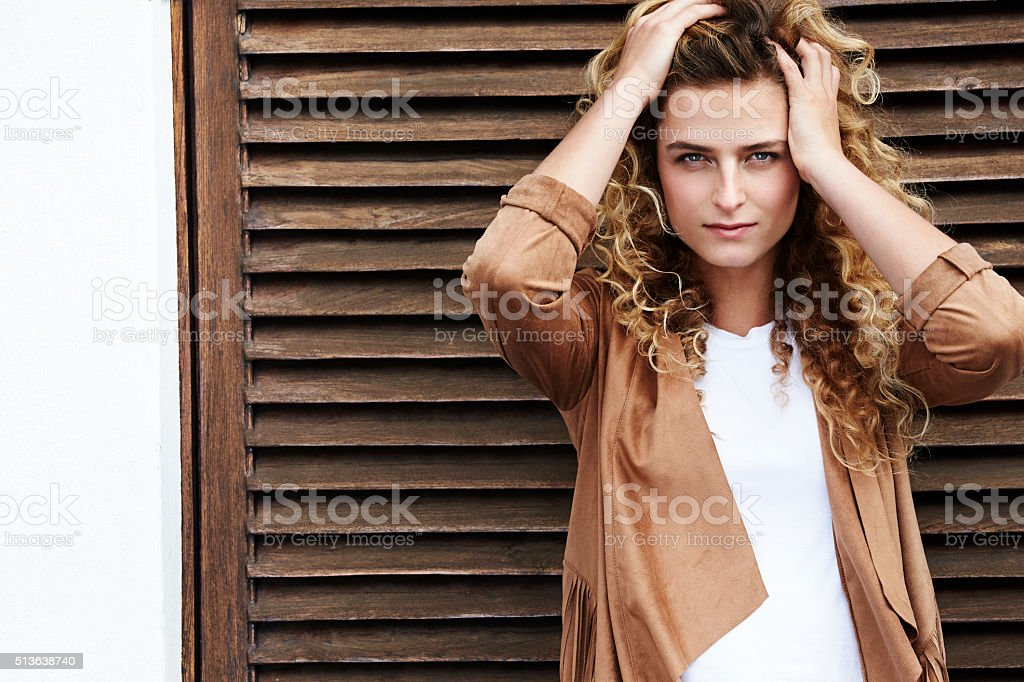 Beautiful woman with hands in hair, portrait stock photo