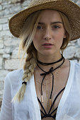 Beautiful woman with hat and pigtail