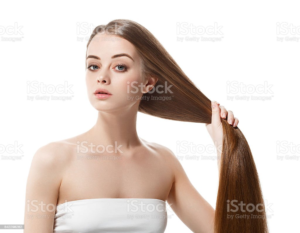 Beautiful woman with healthy long hair keep it in hand stock photo