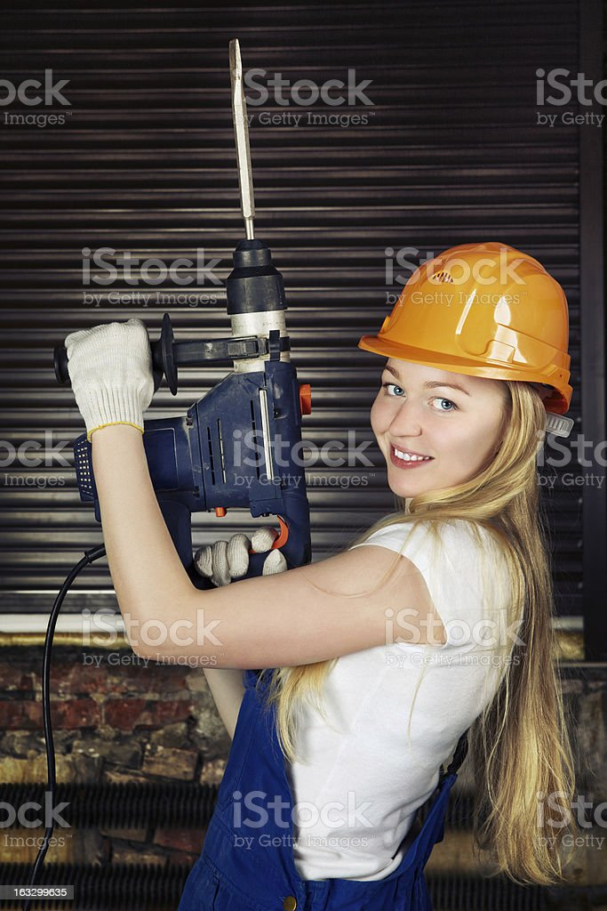Beautiful Woman With Heavy Drill royalty-free stock photo