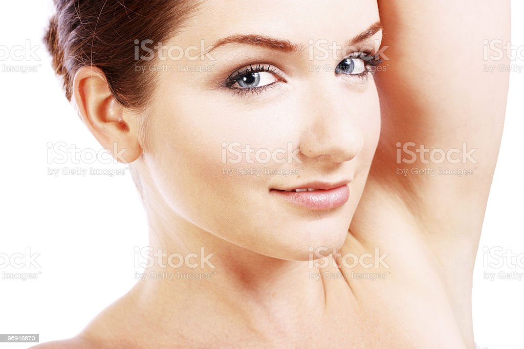 Beautiful woman with her arm up stock photo