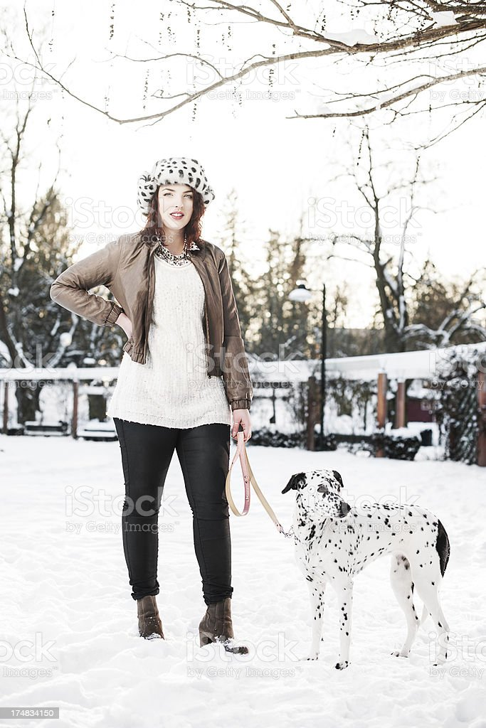 Beautiful woman with her dog royalty-free stock photo