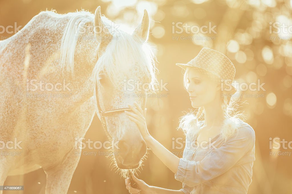 Beautiful Woman with Horse Enjoying Summer Day royalty-free stock photo
