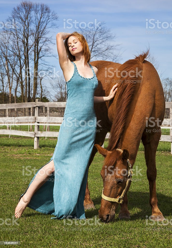 Beautiful Woman With Horse in Rural Pasture royalty-free stock photo