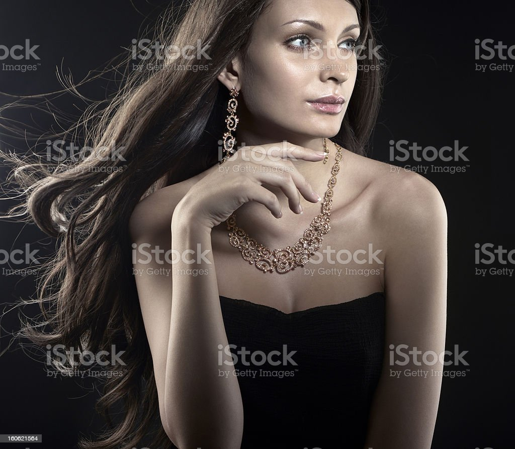 Beautiful woman with jewellery royalty-free stock photo