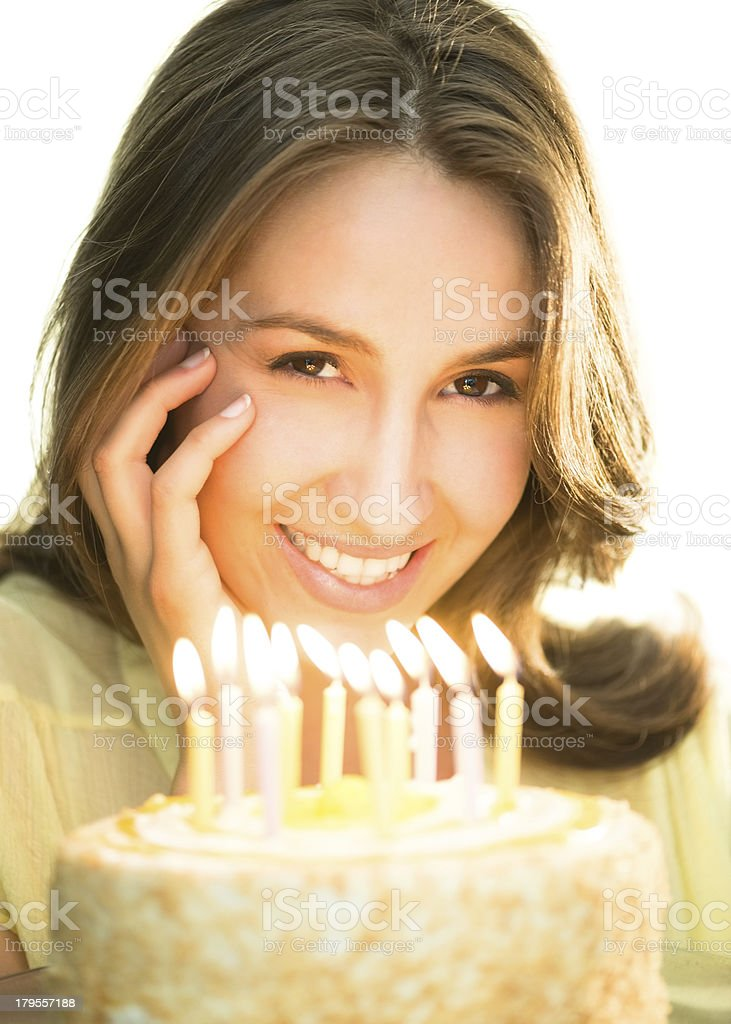 Beautiful Woman With Lit Candles On Cake royalty-free stock photo