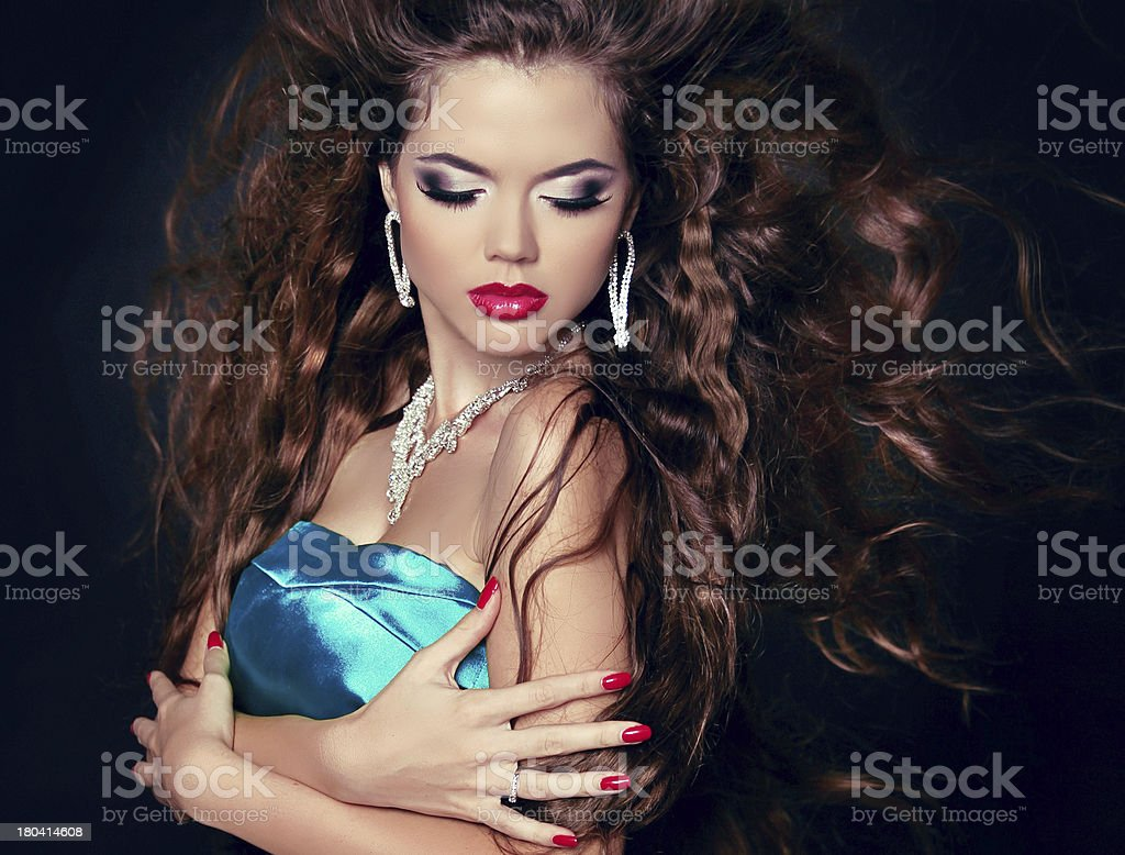 Beautiful woman with long brown blowing hair. Fashion girl royalty-free stock photo