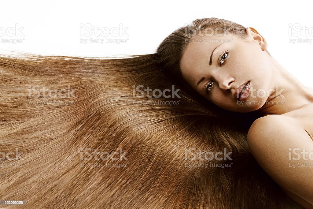 A beautiful woman with long brown hair laid out flat across royalty-free stock photo