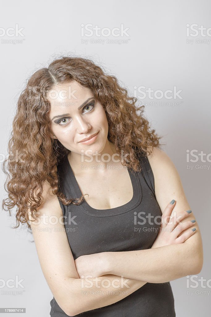 Beautiful woman with long curly hair face and shoulders royalty-free stock photo