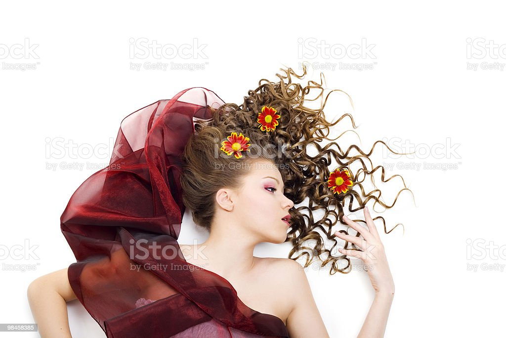 Beautiful woman with long curly hair royalty-free stock photo