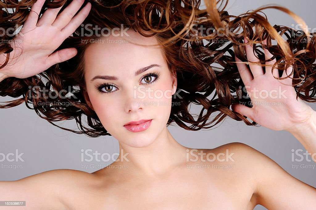 beautiful  woman with  long curly hairs royalty-free stock photo