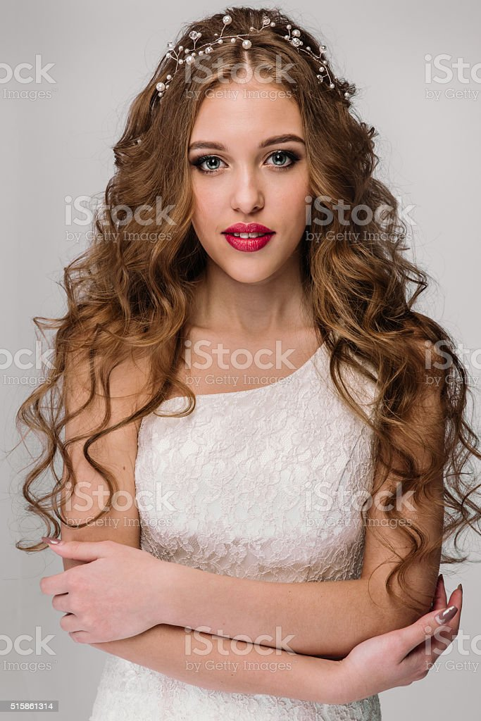 Beautiful woman with long hair wearing wedding dress stock photo