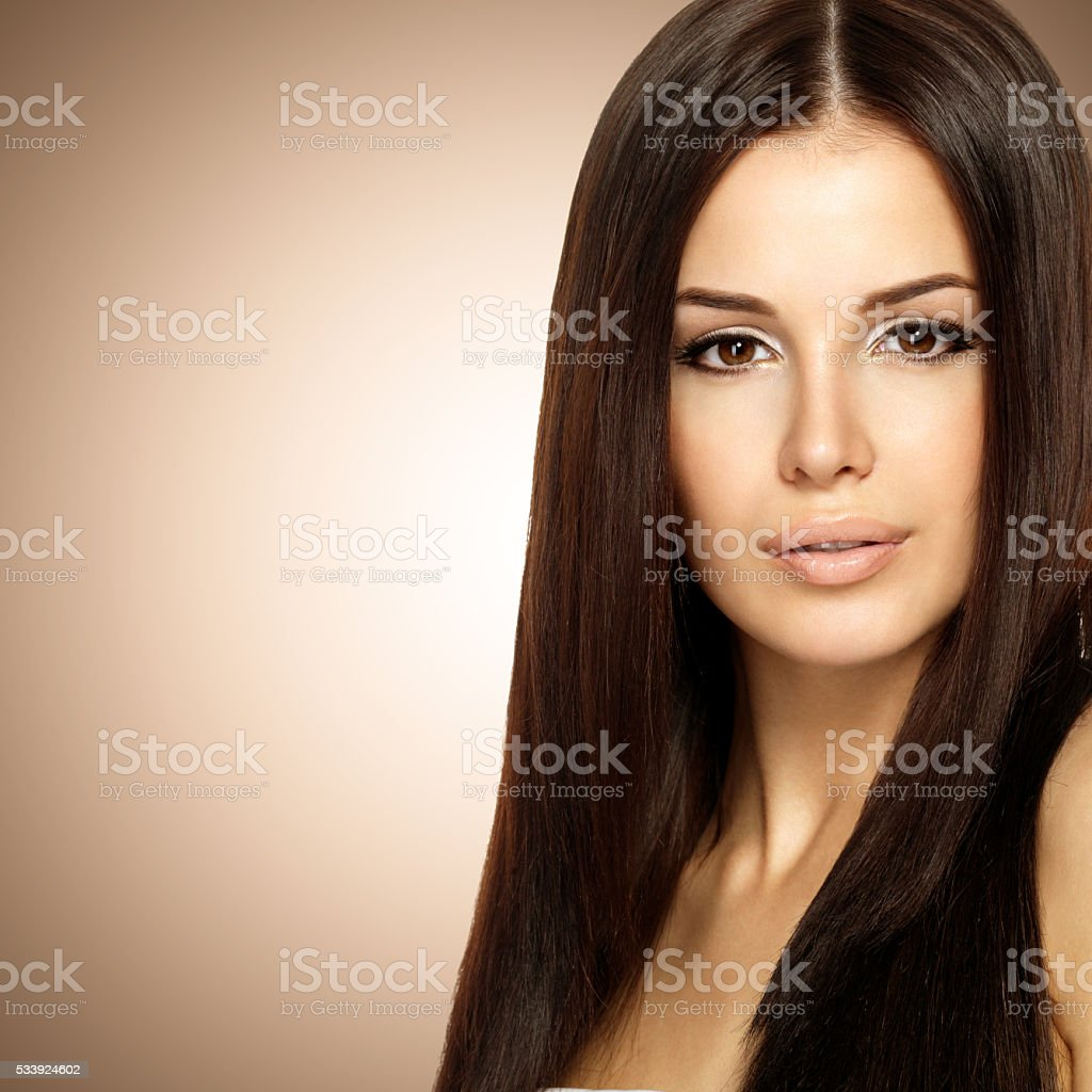 Beautiful woman with long straight brown hair. stock photo