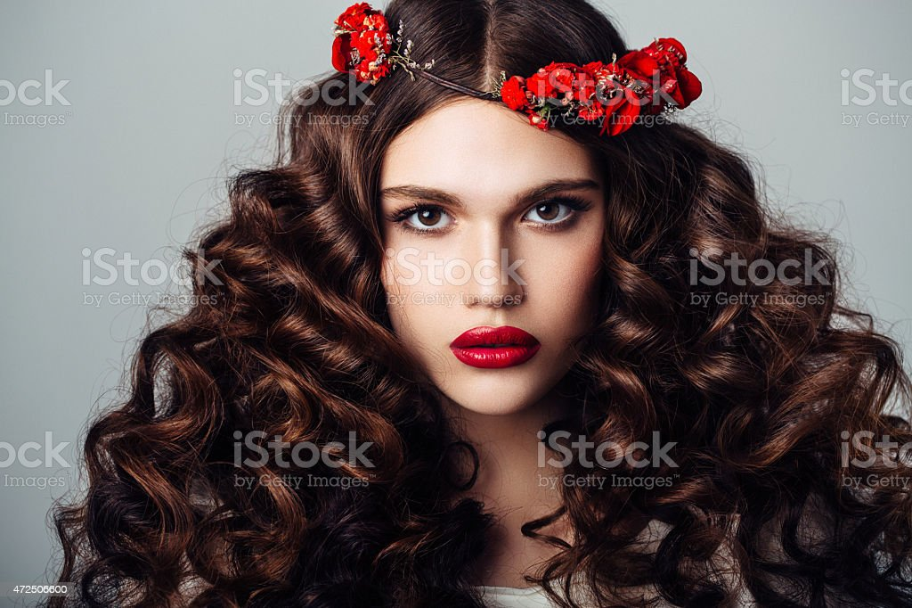 Beautiful woman with luxurious curls stock photo