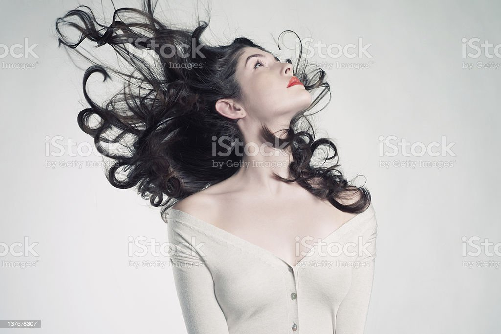 Beautiful woman with magnificent long brown hair stock photo