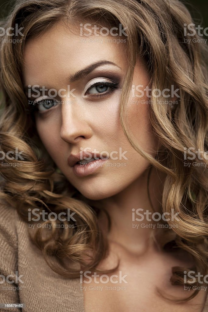 Beautiful woman with makeup and hairstyle royalty-free stock photo