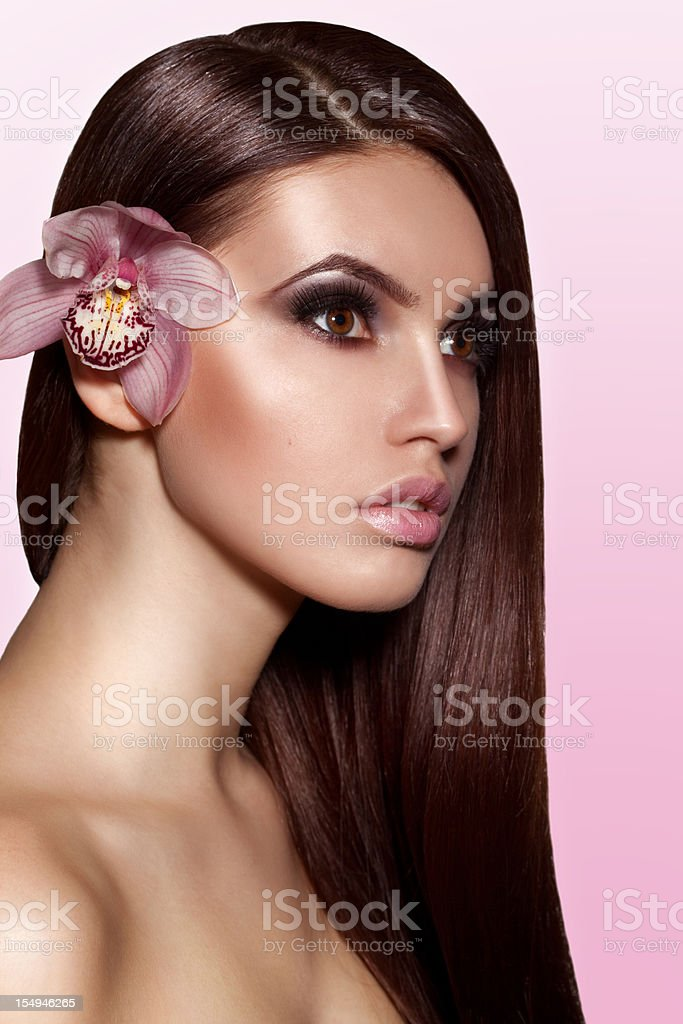 Beautiful woman with makeup and orchid royalty-free stock photo