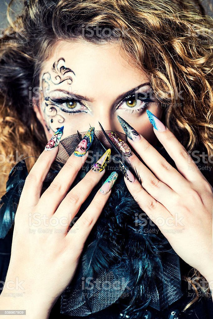 Beautiful Woman with Manicure Nail Gel and Face Art stock photo