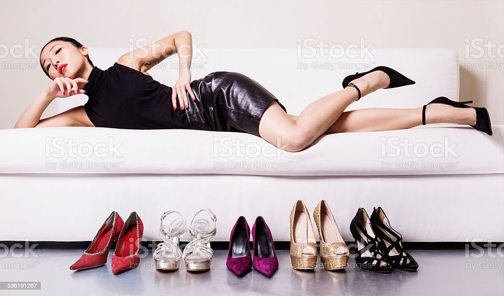 Beautiful woman with many shoes. stock photo
