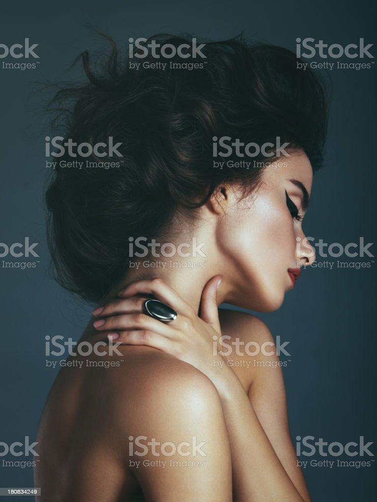 Beautiful woman with messy hair bun stock photo