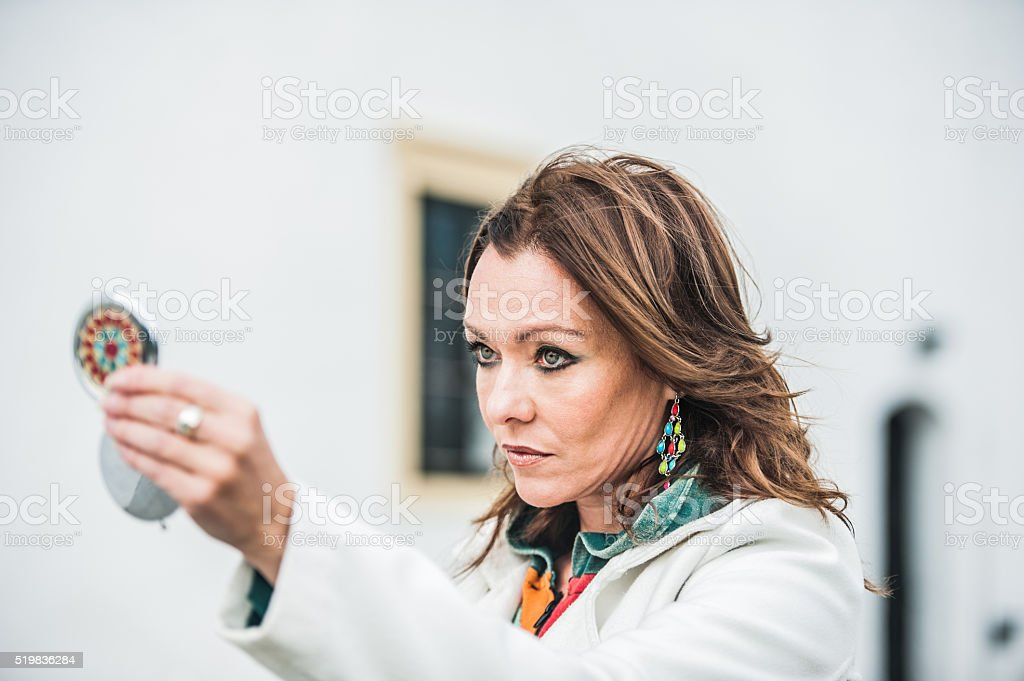 Beautiful woman with mirror stock photo