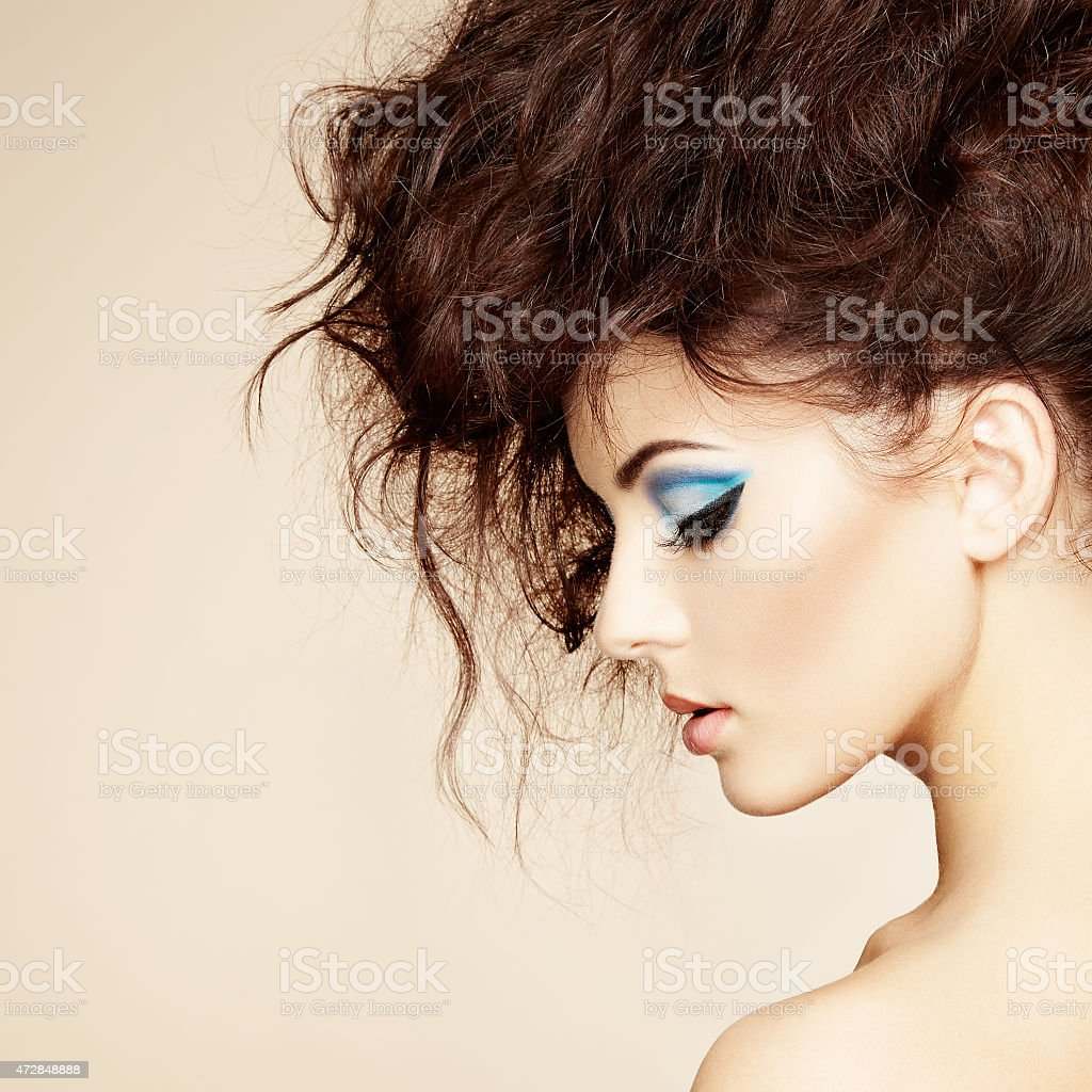 Beautiful woman with modern hair and blue eye makeup stock photo