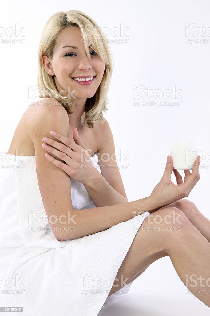 Beautiful woman with moisturizer royalty-free stock photo