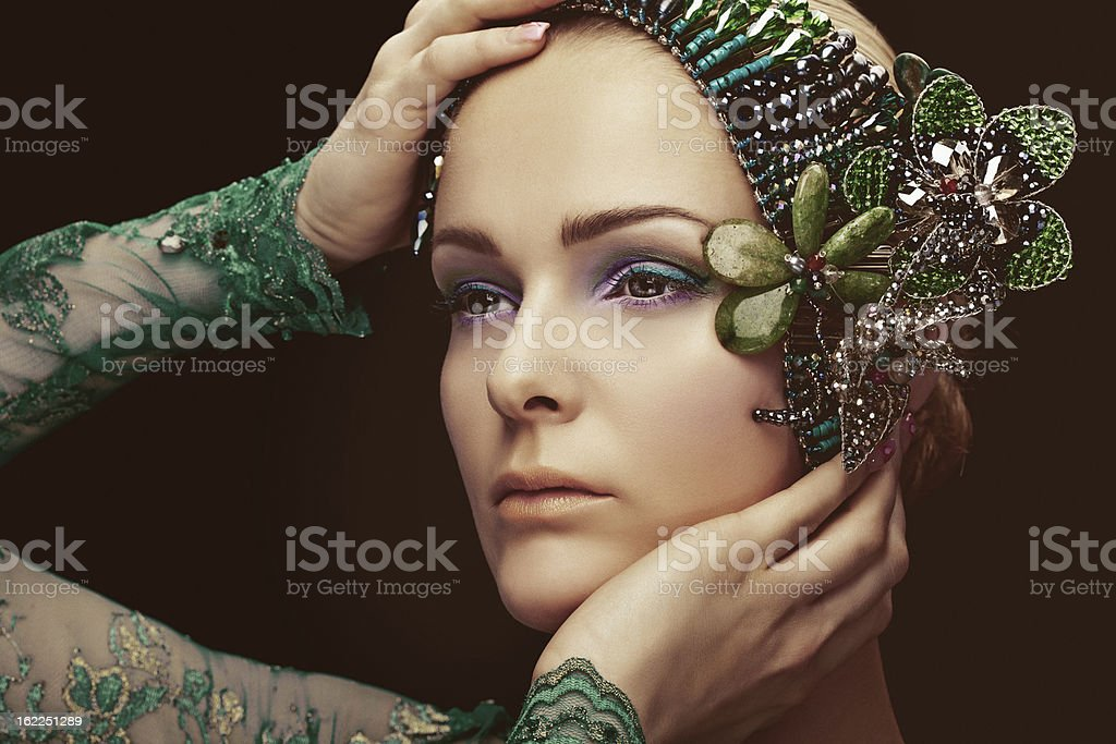 beautiful woman with multicolored make-up against black background royalty-free stock photo