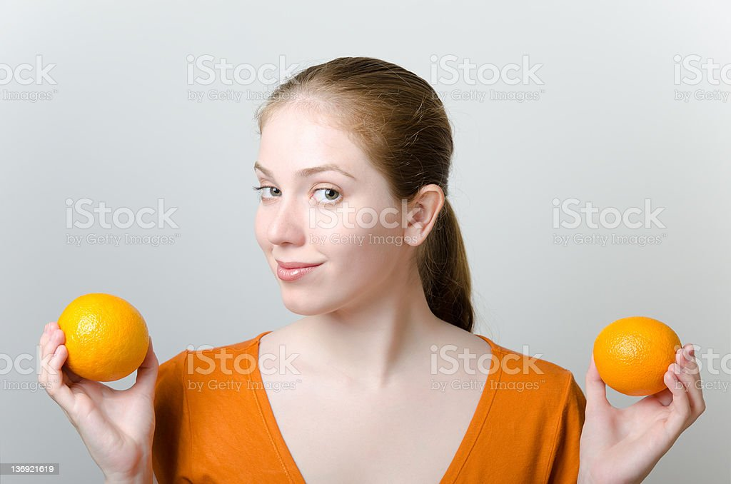 Beautiful woman with oranges royalty-free stock photo