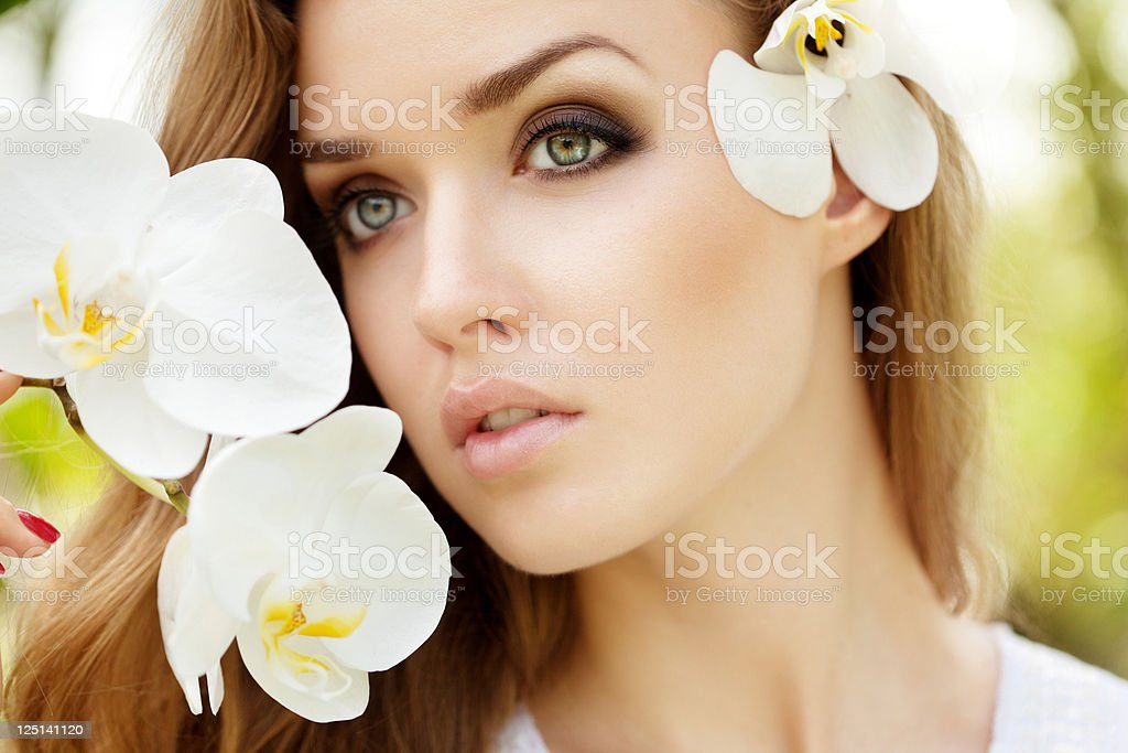 Beautiful woman with orchids stock photo