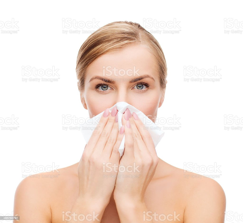 beautiful woman with paper tissue stock photo