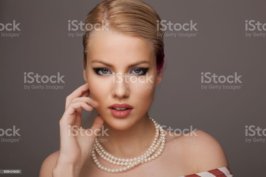 Beautiful woman with pearls stock photo