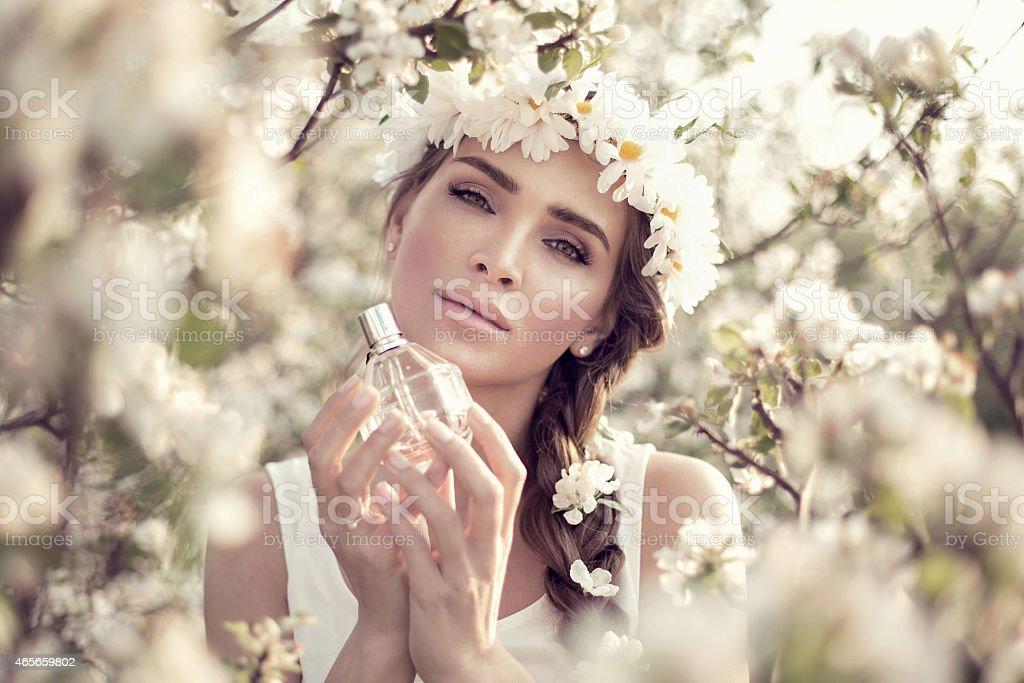 Beautiful woman with perfume bottle stock photo