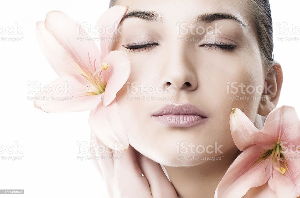 Beautiful woman with pink lily royalty-free stock photo