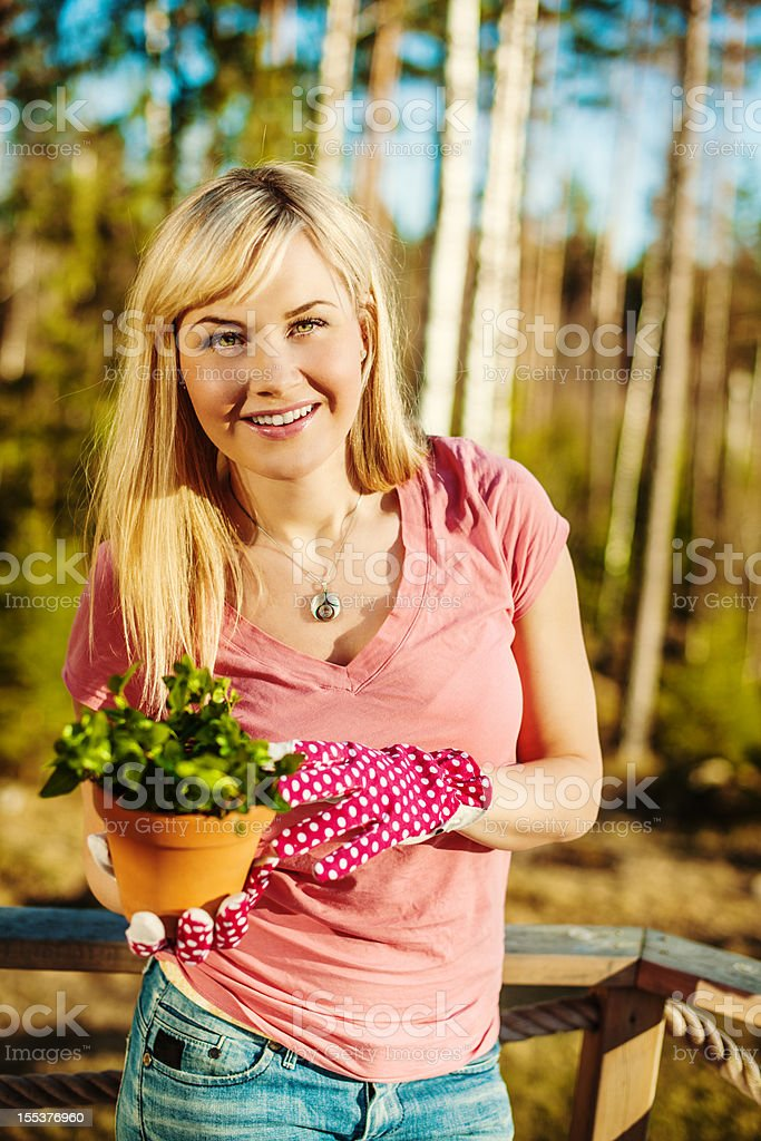 Beautiful woman with plant royalty-free stock photo