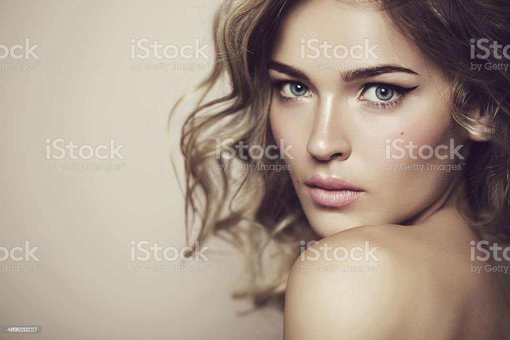Beautiful woman with professional makeup and hair stock photo