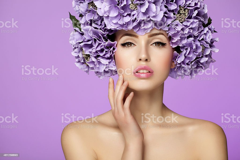 Beautiful woman with purple flowers stock photo