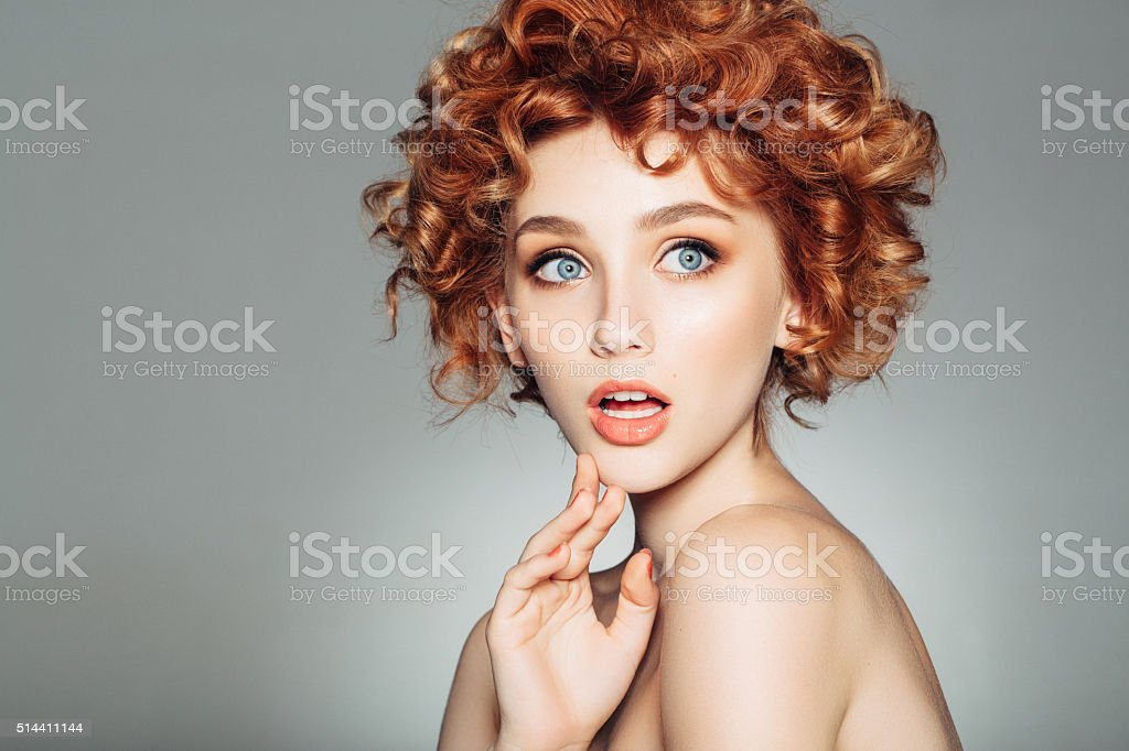 Beautiful woman with red curly hair stock photo