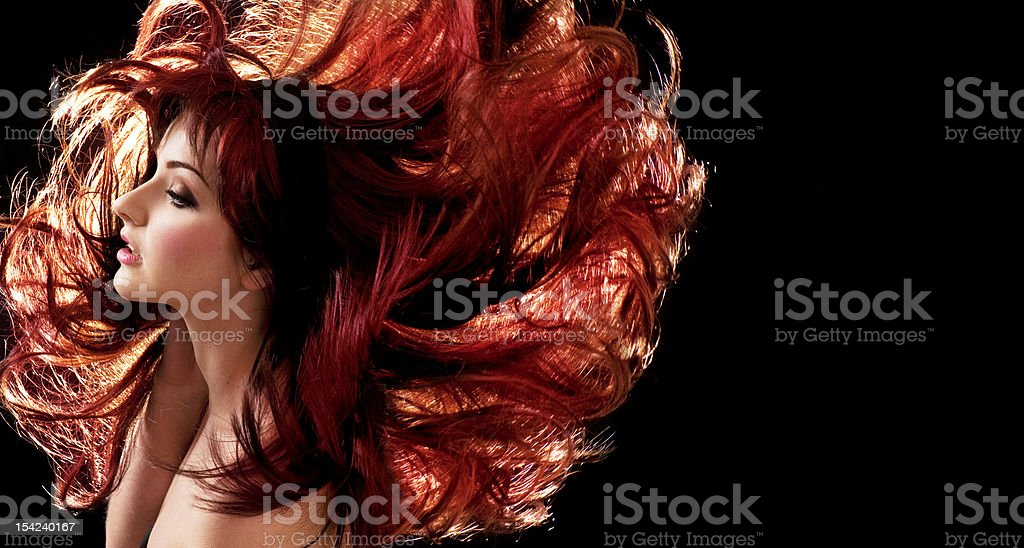 A beautiful woman with red hair stock photo