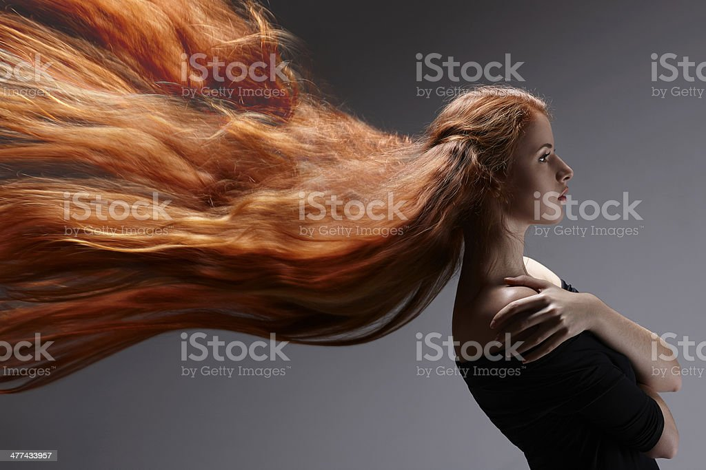 Beautiful woman with red hair stock photo