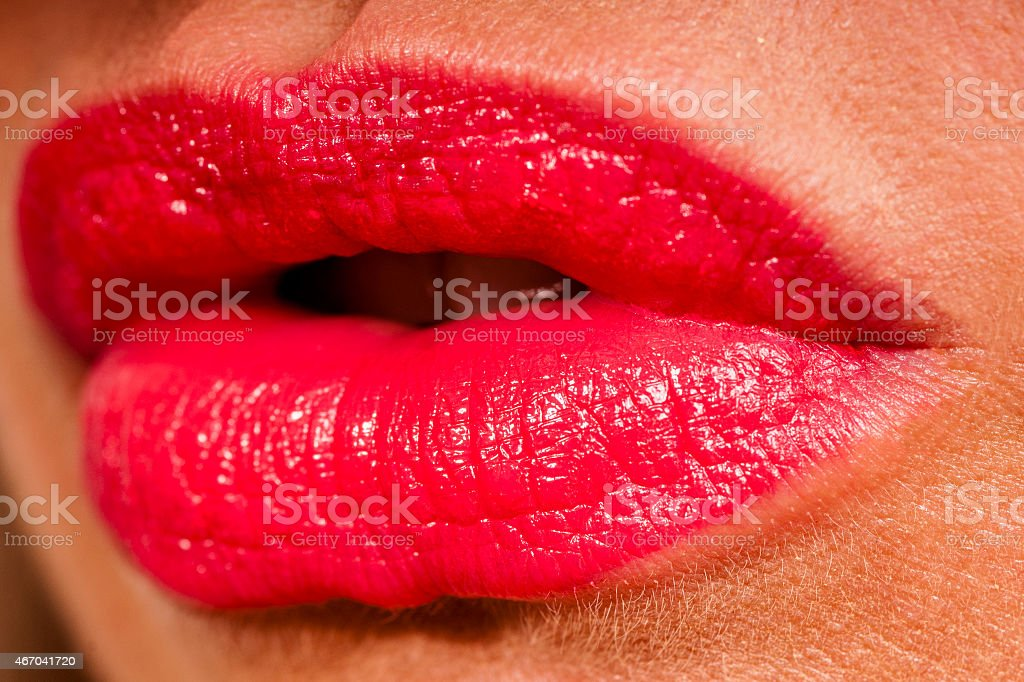 Beautiful woman with red shiny lips close up stock photo