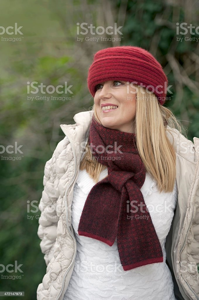 Beautiful Woman with Red Woolen Cap and Scarf royalty-free stock photo