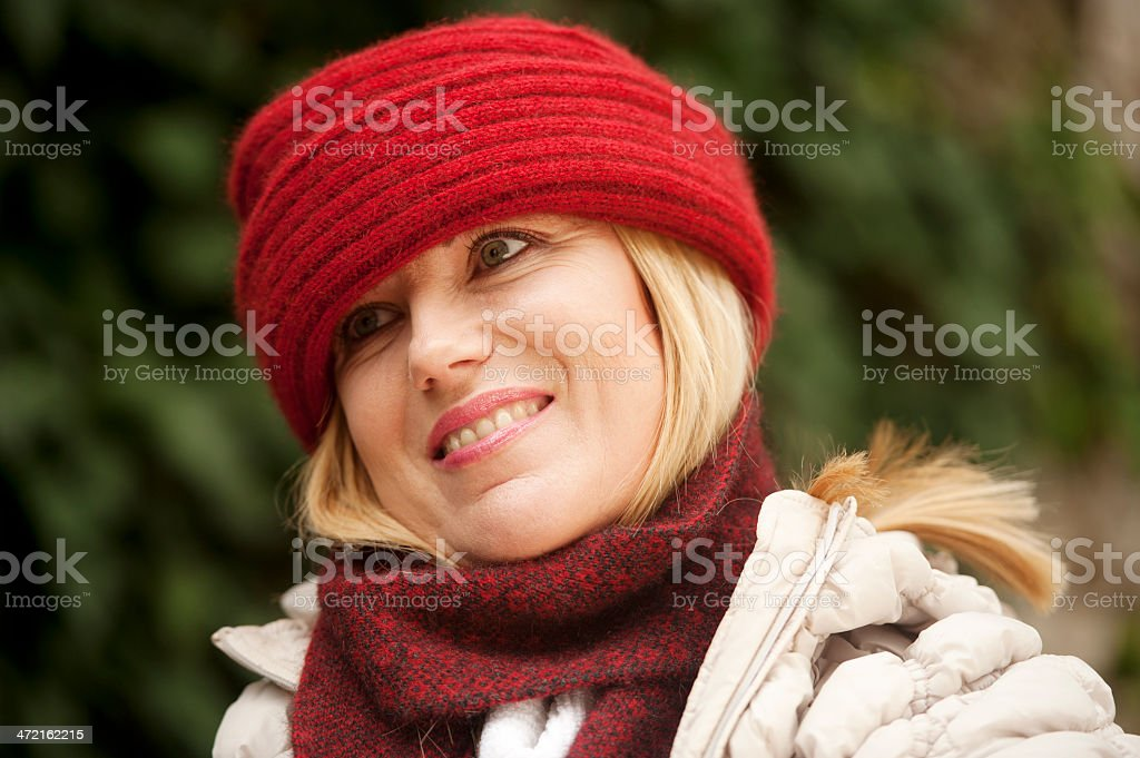 Beautiful Woman with Red Woolen Cap and Scarf stock photo