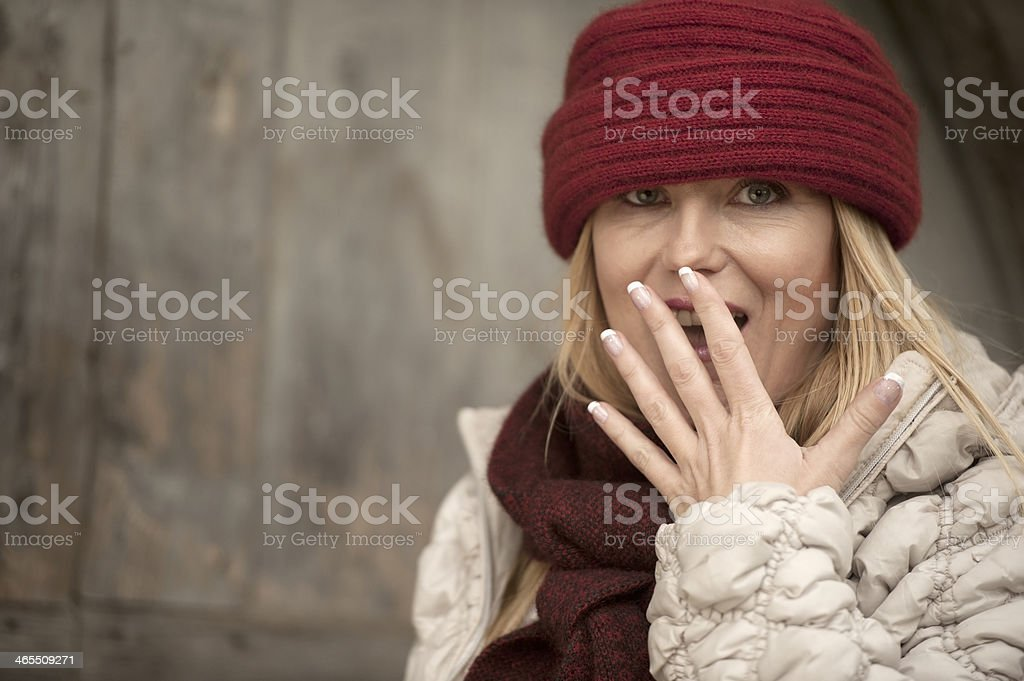 Beautiful Woman with Red Woolen Cap stock photo